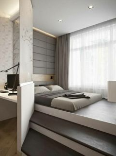a-minimalist-and-all-zen-bedroom-with-a-bed-placed-on-a-platform-a-white-nightstand-neutral-bedding-and-an-upholstered-wall