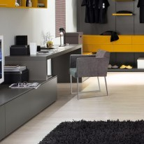 a-minimalist-home-office-with-a-sleek-grey-desk-and-a-storage-unit-a-grey-chair-and-a-yellow-shelf-over-the-desk