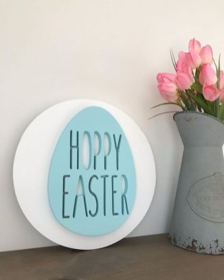 a-modern-and-creative-spring-sign-a-white-circle-with-a-blue-Easter-egg-is-a-lovely-and-fun-idea-to-rock
