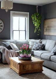 a-monochromatic-living-room-with-potted-plant-and-some-tulips-that-refresh-the-space-and-make-it-spring-like
