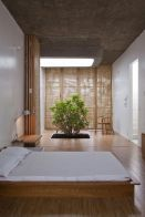 a-natural-zen-bedroom-with-low-wooden-furniture-a-planted-tree-wooden-screens-and-space-dividers-is-a-unique-space