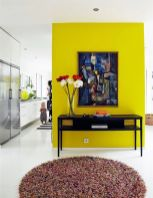 a-neon-yellow-accent-wall-a-bold-artwork-adna-vintage-console-table-with-blooms-to-make-use-of-this-awkward-nook