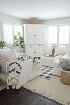 a-neutral-farmhouse-living-room-with-neutral-furniture-printed-textiles-potted-greenery-and-some-lavender-feels-like-spring
