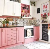 a-playful-kitchen-with-pink-and-white-cabinetry-a-Dolmatin-backsplash-and-brass-handles-and-fixtures-is-bold-and-cool