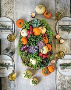 a-pretty-harvest-centerpiece-of-greenery-succulents-and-colorful-veggies-is-a-gorgeous-idea-to-go-for