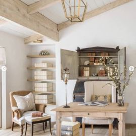 a-refined-farmhouse-home-office-with-a-wooden-desk-vintage-chairs-a-storage-niche-and-open-shelves-is-welcoming