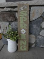 a-rustic-spring-sign-with-green-letters-a-white-bloom-is-a-simple-and-easy-idea-for-a-rustic-outdoor-space