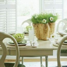 a-rustic-spring-tablescape-with-woven-chargers-green-porcelain-a-catchy-wooden-planter-and-white-blooms