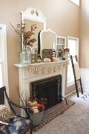 a-simple-Thanksgiving-mantel-with-velvet-pumpkins-oversized-vintage-mirrors-a-dried-leaf-arrangement-in-a-glass-vase-plus-candles