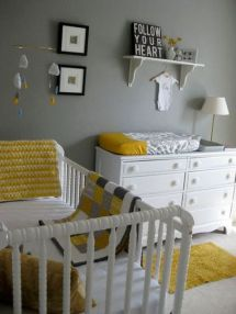 a-simple-and-cool-grey-and-white-nursery-accented-with-yellow-linens-with-modern-furniture-and-a-small-gallery-wall