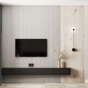 a-small-and-sleek-black-TV-unit-attached-to-the-wall-is-a-timeless-solution-for-every-space