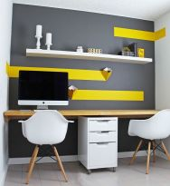a-small-contemporary-home-office-with-a-grey-accent-wall-with-bold-yellow-touches-and-an-open-shelf-a-shared-desk-and-a-couple-of-chairs