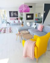 a-spring-living-room-zone-with-a-bold-yellow-chair-pink-linens-a-hot-pink-sheer-pendant-lamp