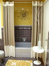 a-stylish-mid-century-modern-bathroom-with-yellow-and-grey-walls-a-sunburst-decoration-color-block-curtains