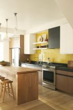 a-stylish-modern-kitchen-with-black-white-and-stained-cabinets-open-shelves-and-a-bold-yellow-hex-tile-backsplash-plus-a-kitchen-island