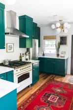 a-teal-kitchen-with-white-countertops-a-backsplash-and-a-bold-boho-rug-plus-a-retro-lamp-is-a-cool-idea