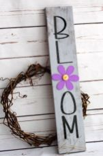 a-vine-wreath-paired-wiht-a-grey-rustic-sign-with-a-bold-purple-bloom-and-black-letters-is-a-lovely-idea