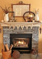 a-vintage-and-rustic-Thanksgiving-mantel-with-a-wooden-bead-and-burlap-garland-plus-pinecones-in-a-bucket-mini-pumpkins-feathers-etal-gourds-and-signs