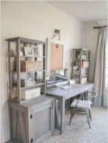 a-vintage-farmhouse-home-office-with-a-wooden-desk-cabinets-and-open-shelves-on-them-and-a-board-in-a-frame
