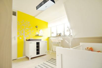 a-vivacious-yellow-and-white-nursery-with-a-painted-accent-wall-in-yellow-wihte-furniture-a-striped-rug-and-a-comfy-lamp-is-wow