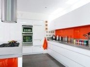 all-white-kitchen-with-orange-accents
