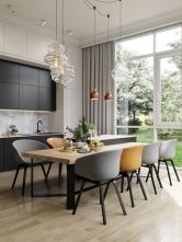 an-elegant-dining-zone-with-a-wooden-table-grey-and-yellow-chairs-glass-and-copper-pendant-lamps-is-very-chic