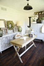 an-inspiring-home-office-with-white-beadboard-walls-a-wooden-desk-a-shabby-chic-storage-unit-a-black-lamp-and-some-decor