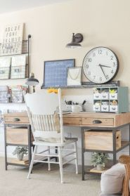 an-inviting-farmhouse-home-office-with-a-wood-and-metal-desk-a-white-chair-storage-units-and-a-large-clock