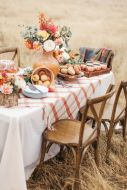 apples-in-a-woven-basket-bright-blooms-fresh-donuts-and-a-bundt-cake-for-a-lovely-Thanksgiving-tablescape