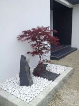 black-and-white-pebbles-a-large-rock-and-a-red-maple-mini-tree-at-the-entrance-will-make-the-space-look-wow