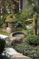grass-and-greenery-pebbles-a-stone-and-bamboo-fountain-a-stone-and-moss-lantern-for-creating-a-lovely-Japanese-space