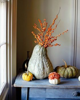 heirloom-pumpkins-with-blooms-and-an-oversized-gourd-with-berried-branches-is-a-lovely-all-natural-decoration