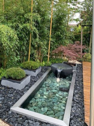 pebbles-and-rocks-a-stone-fountain-grasses-in-flower-beds-are-amazing-to-complete-a-zen-like-front-yard