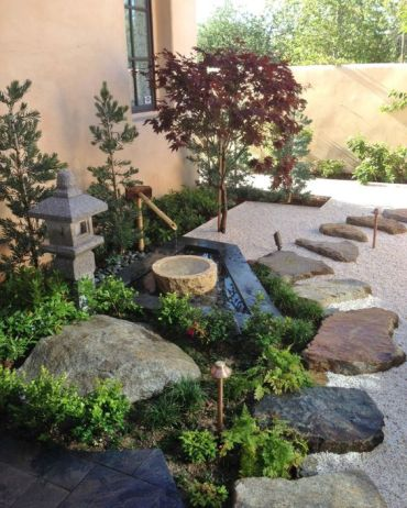 pebbles-rocks-and-rock-tiles-a-stone-and-bamboo-fountain-greenery-a-stone-lantern-and-thin-Japanese-style-trees-for-a-cozy-feel
