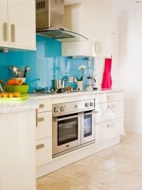 white-kitchen-with-turquoise-backsplash