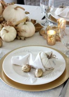 white-pumpkins-dried-leaves-gilded-nuts-and-candles-in-mercury-glass-candleholders-for-a-chic-and-refined-Thanksgiving-tablescape