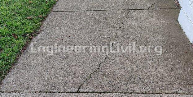 Flexural cracks on pavement slab due to lack of reinforcement or expansion of subgrage - EngineeringCivil.org