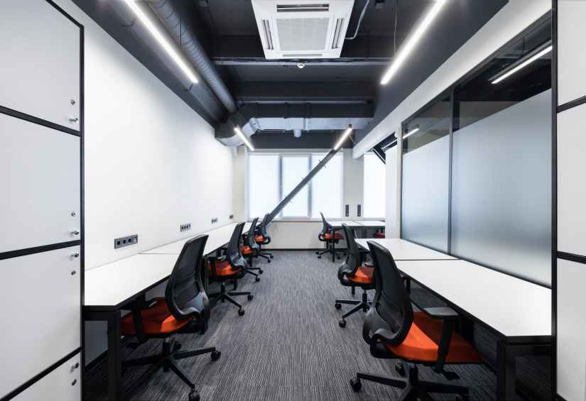 open space office with red armchairs Glass Partitions