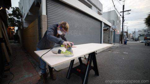 Sanding-plywood-DIY-Murphy-Bed