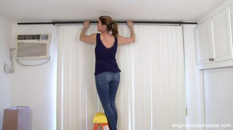 putting-on-curtain-rod