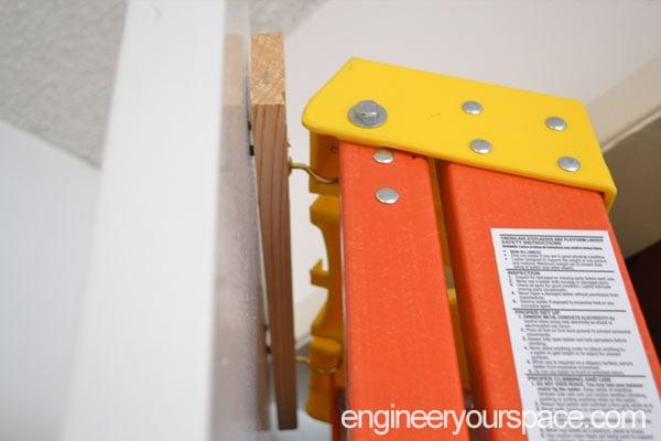 DIY-Over-the-door-hooks-for-a-ladder-