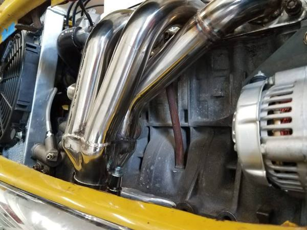 stainless steel header on a Honda D16 motor in a 1976 Mini built by Mcgee's Custom Minis