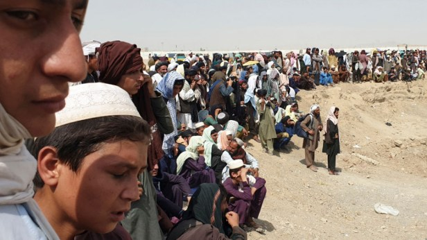 Hundreds of people tried to cross into Pakistan from the Afghan side of the border [AFP]