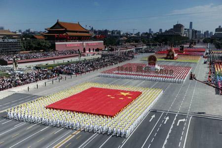 The phalanx of national flag receives inspection in a parade of the celebrations for the 60th anniversary of the founding of the People's Republic of China, on Chang'an Street in central Beijing, capital of China, Oct. 1, 2009. (Xinhua/Yang Lei)