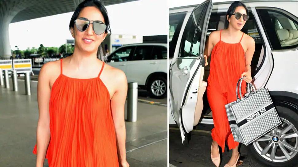Image result for kiara advani in orange dress in airport