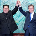 Two Koreas mark Moon-Kim summit anniversary with different tones