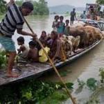 India monsoon floods kill at least 100