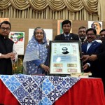 PM releases commemorative stamp, coins on Mujib Borsho