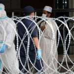 Malaysia rounding up migrants to contain virus spread