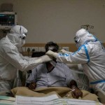 India's virus cases cross 200,000, peak still weeks away
